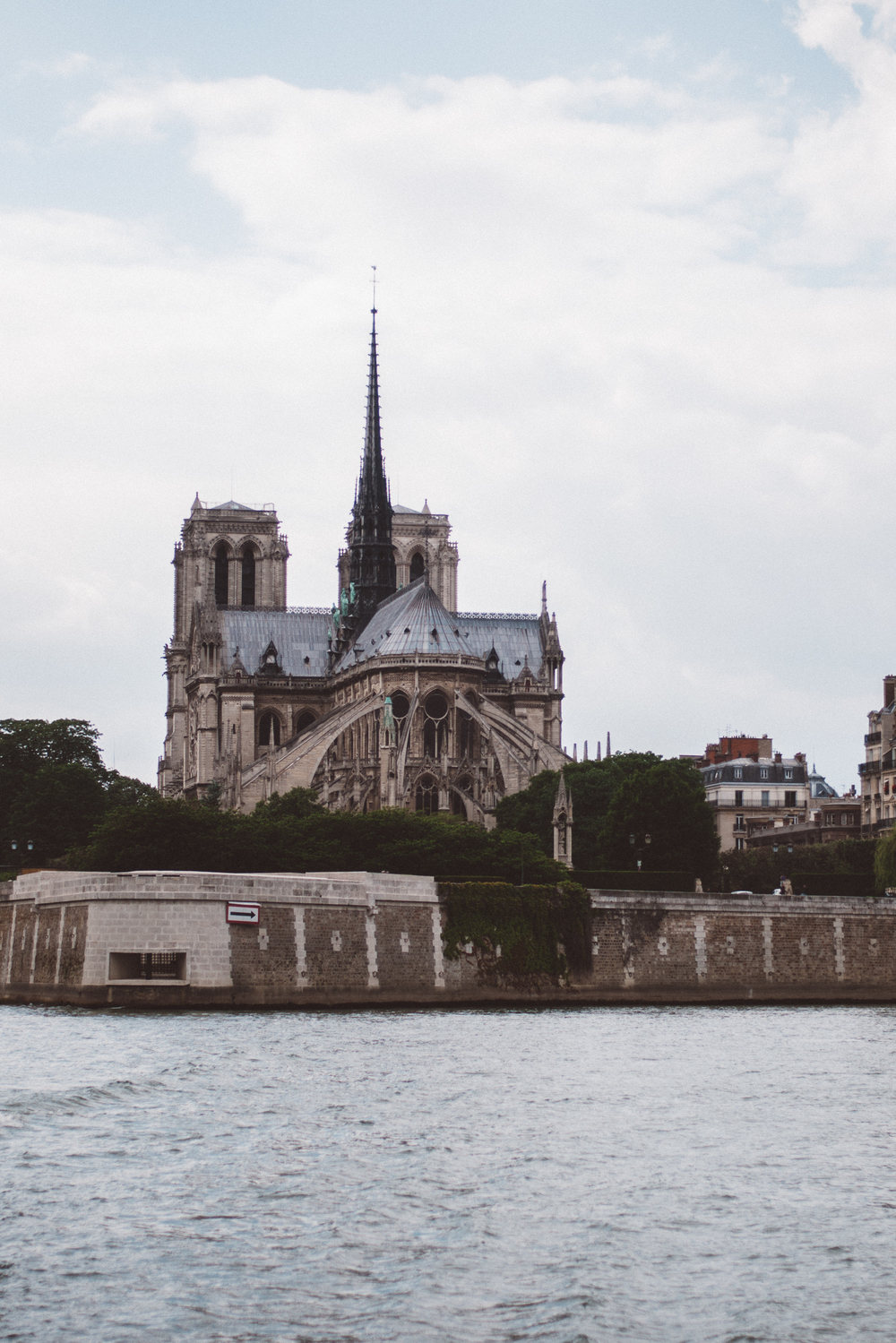 View of Notre Dame from the Seine River in Paris, France.