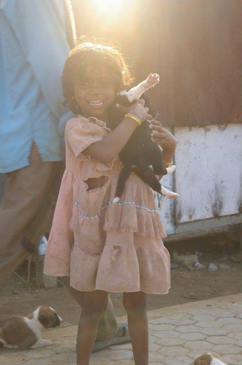 Happy girl with puppy - Bodhgaya, Bihar