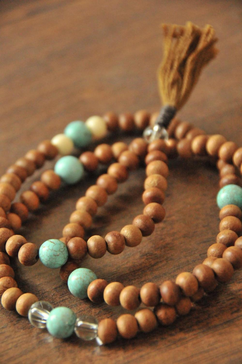 Sandalwood mala  (This No Mind Mala is called Vijaya, and holds Sandalwood, Turquoise and Clear Quartz)