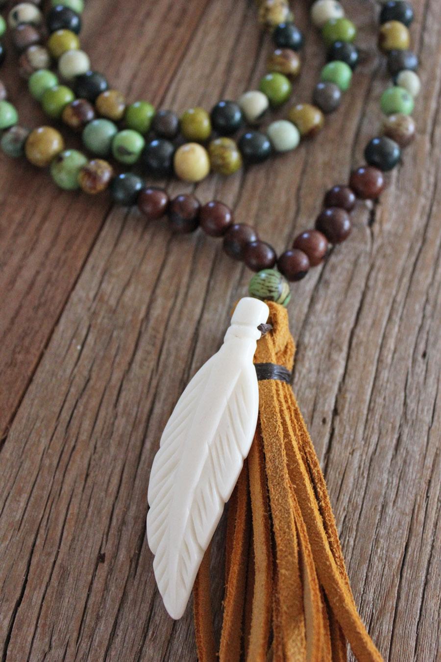 Multi-colored Acai Seeds and Bone Feather charm