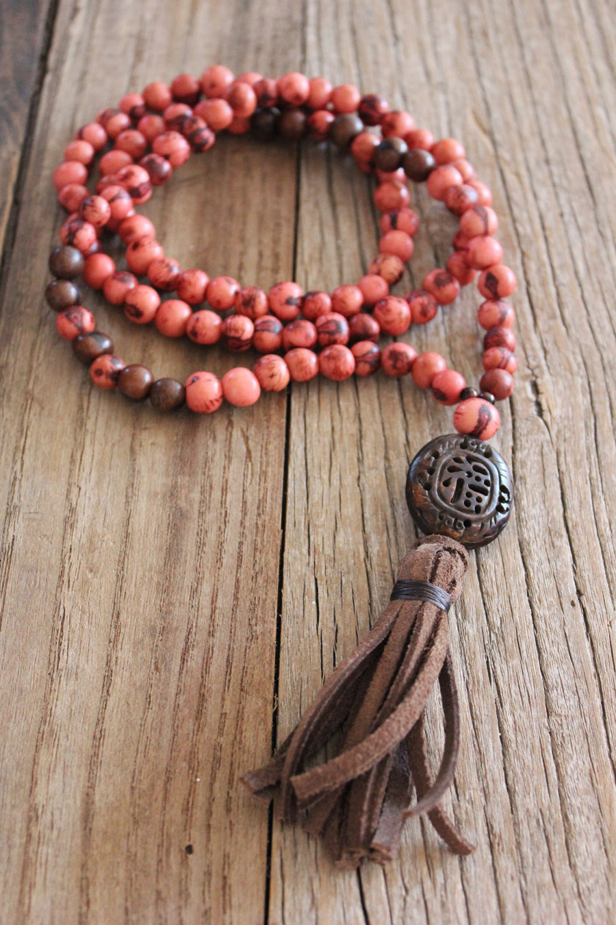 Pink and Brown Acai seeds - with brown carved bone charm