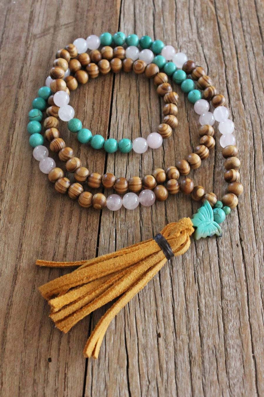Tibetan Wood, Rose Quartz, Turquoise Howlite, Turquoise Butterfly charm and pumpkin suede tassel
