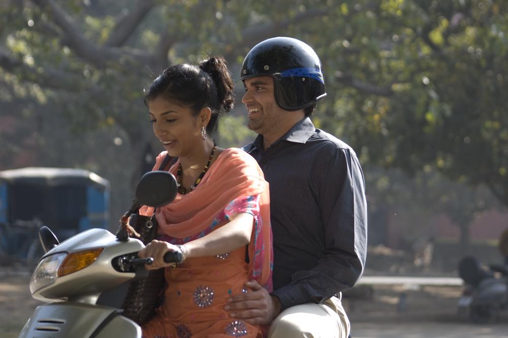 Ashok & Amita on bike.jpg