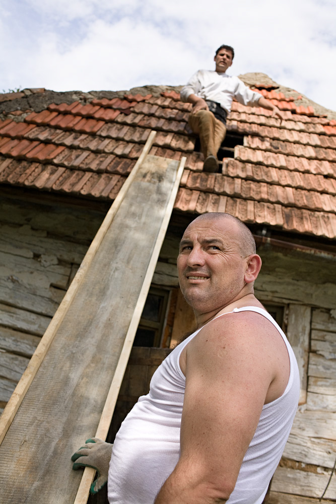 Zece-Hotare village, Romania. Family and friends work together on the restoration of Dmitru Matei's house. The roof (tiles and wooden structure were removed, by hand, in one afternoon.