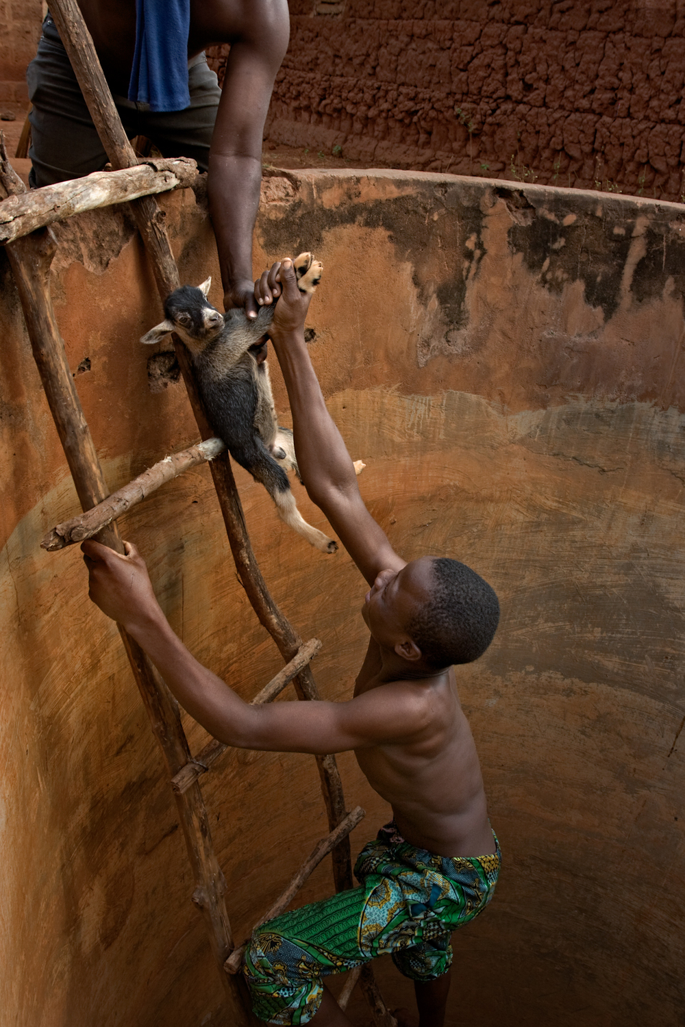Rescuing a baby goat from the dry well, Ketou.