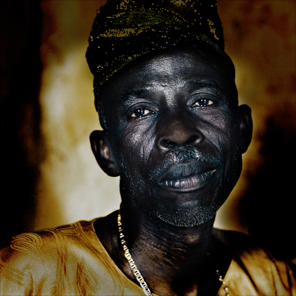 "An elderly ""babalawo"", initiate and traditional priest of the cult of Ifa, Ketou."