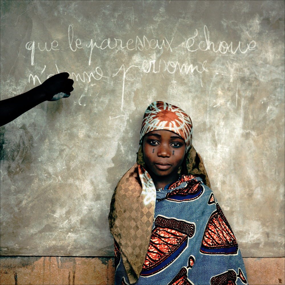 "Tchadé in front of the blackboard,  Ketou. The text reads ""that lazy should fail surprises nobody""."