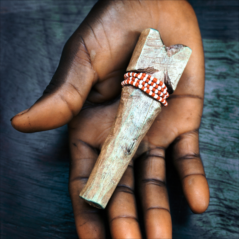 Wooden axe symbol of the orisha Shango, Ketou.