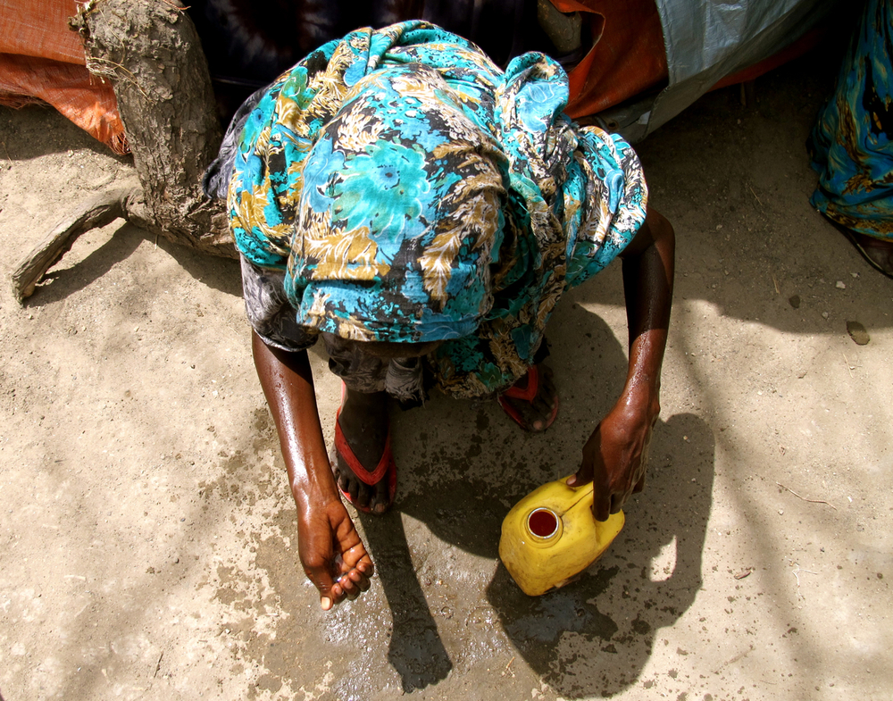 Foot washing.  Howl Wadaag IDP camp, Mogadishu, Somalia. August 2011.