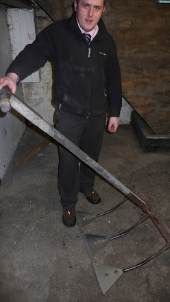 One of Fawcett's maltsters showing off his rake
