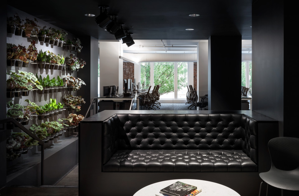This potted plant wall serves to greenify the ultra-hip urban environment.