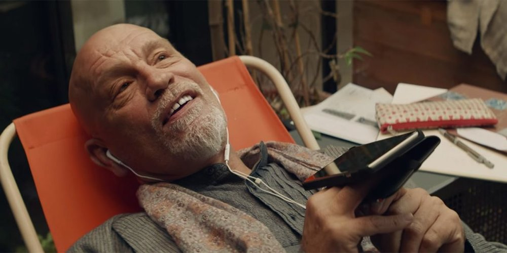 John Malkovich makes a phone call to land johnmalkovich.com.