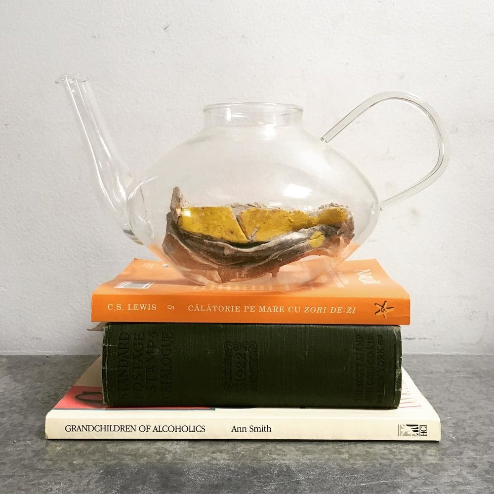"Untitled  2016  10"" x 6"" x 14""  Pyrex teapot, books, b-mix and glaze"