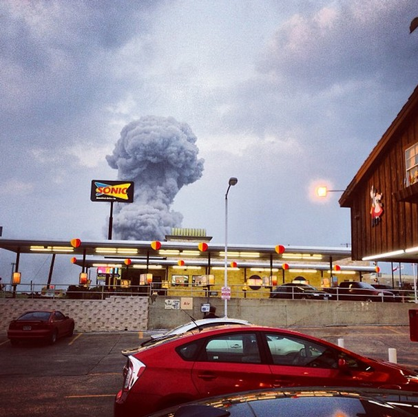 A plume of smoke rises from a fertilizer plant fire in West, Texas on Wednesday, April 17, 2013. The explosion at a fertilizer plant near Waco injured dozens of people and sent flames shooting high into the night sky, leaving the factory a smoldering ruin and causing major damage to surrounding buildings. Photo by Andy Bartee