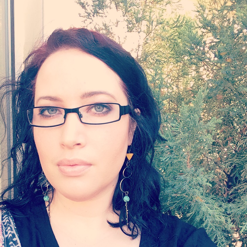 Wearing some   Roots and Feathers   earrings!