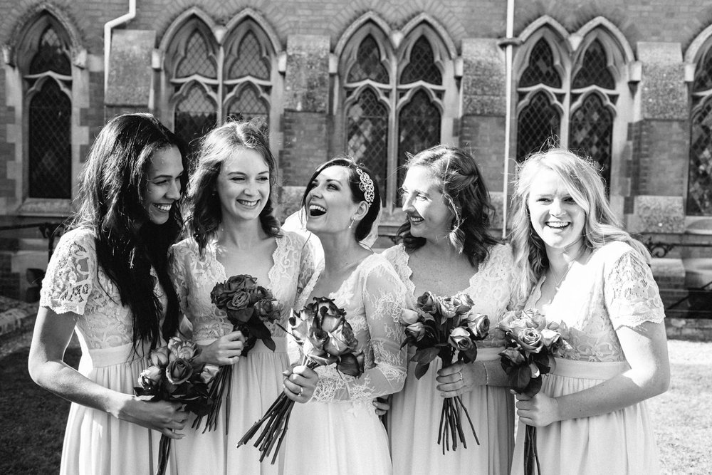 Bride with bridesmaids in a candid natural group shot