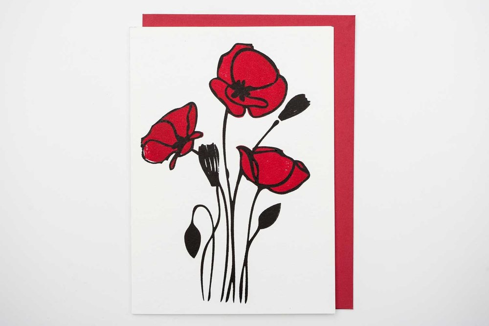 "Size A7. Comes with recycled red envelope. Available blank inside, or printed with the message ""Love Blooms"" with an attached pack of seeds, and printed Papaver rhoeas beneath."