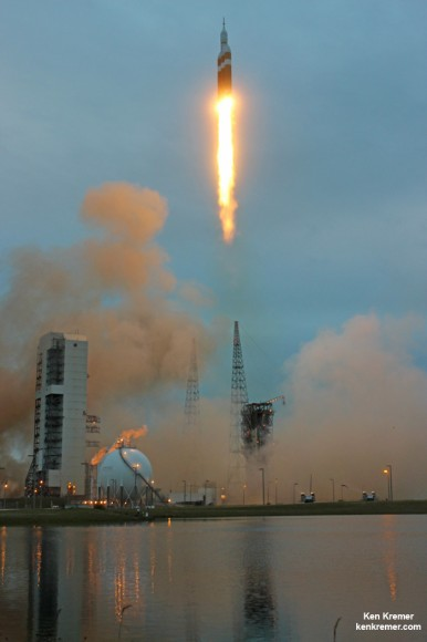 NASA's first Orion spacecraft blasts off at 7:05 a.m. atop United Launch Alliance Delta IV Heavy Booster at Space Launch Complex 37 (SLC-37) at Cape Canaveral Air Force Station in Florida on Dec. 5, 2014. Launch pad remote camera view. Credit: Ken Kremer – kenkremer.com