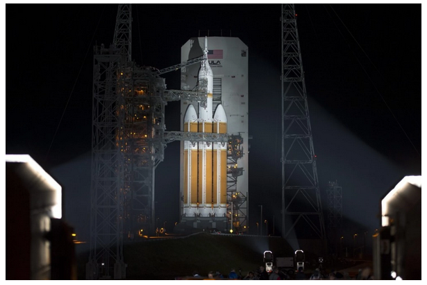 A handout picture made available by NASA shows NASA's Orion spacecraft, mounted atop a United Launch Alliance Delta IV Heavy rocket after the Mobile Service Tower was finished rolling back at Cape Canaveral Air Force Station's Space Launch Complex 37, Fla., Dec. 4, 2014. (EPA/NASA/Bill Ingalls)