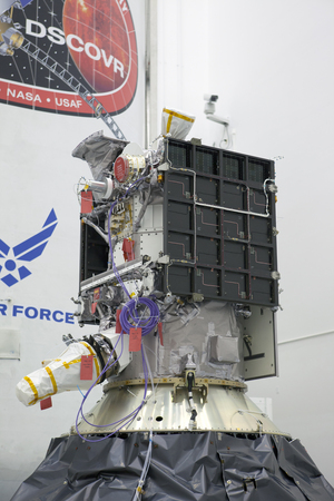 The Deep Space Climate Observatory space weather satellite is prepared for its Feb. 8, 2015 launch atop a SpaceX Falcon 9 rocket in Cape Canaveral, Florida. The satellite will is an early-warning system for solar storms, but will also observe the Earth.   Credit: NASA/Kim Shiflett