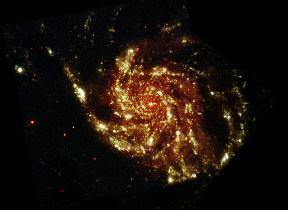 Messier 101, also known as the Pinwheel Galaxy, seen at ultraviolet and optical wavelengths, in an image taken by ESA's XMM-Newton space telescope. A new study looked at the Pinwheel Galaxy in hopes of finding evidence of dark matter interactions with light.   Credit: ESA/XMM & R. Willatt