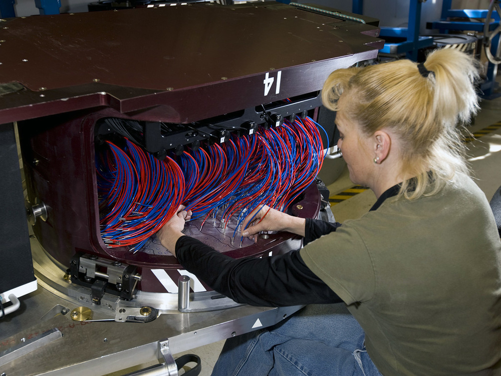 Diana Holder with a plug plate -Courtesy of: SDSS