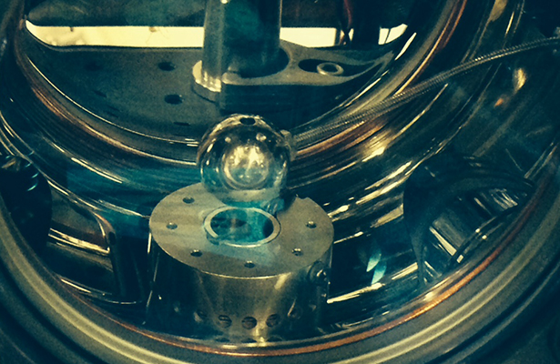 A vacuum chamber with a marble-size sphere at its center was used to test the nature of dark energy.