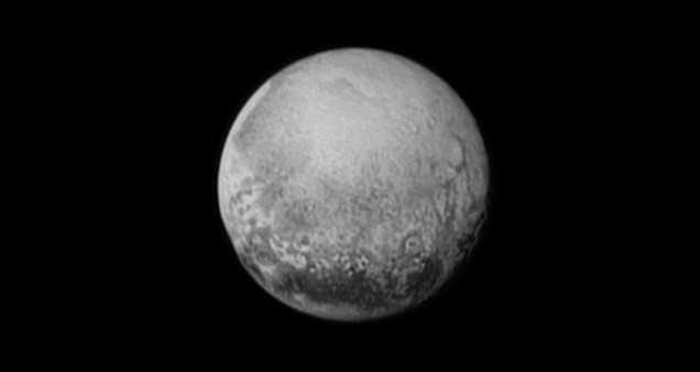 The view of Charon by New Horizons on July 11, 2015 reveals potential craters and chasms. Image credit: NASA/JHUAPL/SWRI
