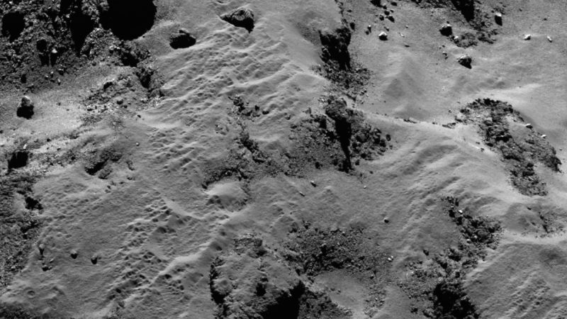 The dusty and pitted Ma'ath region of Comet 67P. This will be the final resting place of the Rosetta spacecraft. (Image: ESA/Rosetta/MPS for OSIRIS Team MPS/UPD/LAM/IAA/SSO/INTA/UPM/DASP/IDA)