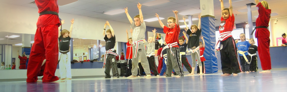 Our Little Dragons program for children ages 4 and 5, focuses on improving listening skills, building self-confidence, self esteem, concentration and discipline while improving motor and coordination skills.  Little Dragon classes are conducted by the same teachers as the regular KYU belt classes and are held throughout the week at times convenient for families with children of this age range  (see schedule) .  If you would like to see if Little Dragons is right for your child, just bring them out to any class and watch how much fun they have!