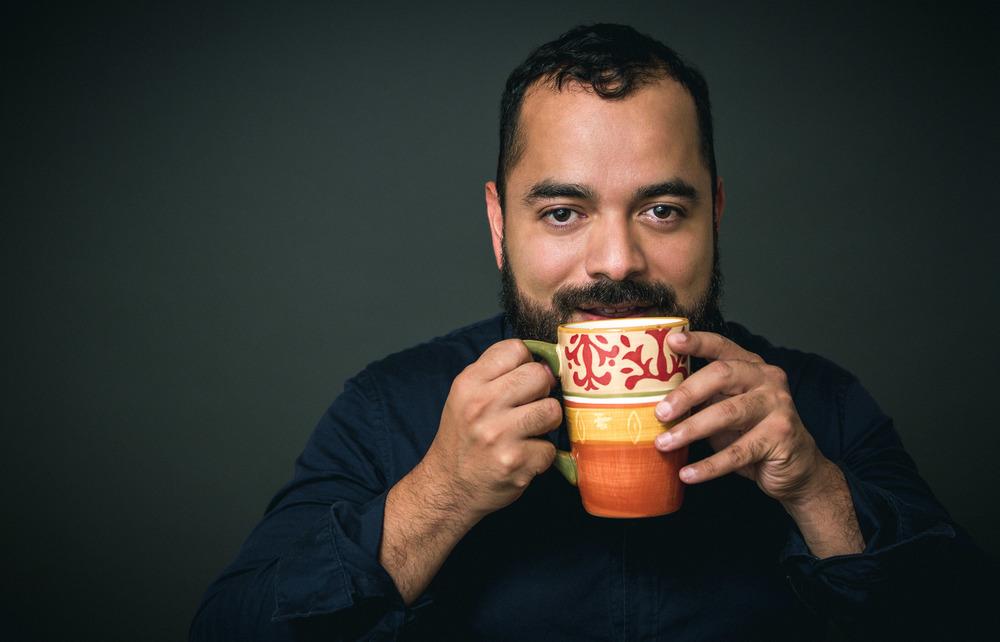 Eduardo Cisneros Drinking Coffee