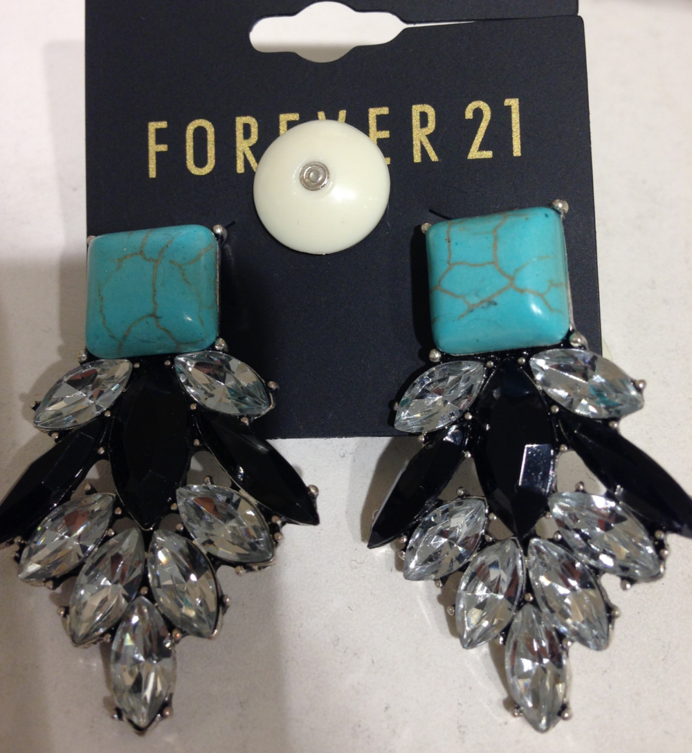 You can't forget about owning a pair of attention grabbing earrings. The colors on this pair are right on point! (Forever 21)