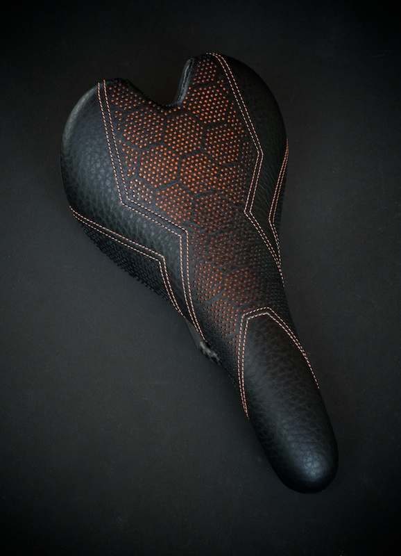 Fizik-Fi'Zi-K-Aliante-Carbon-recover-recovered-reupholstered-repaired-leather-black-orange-hexagon-honeycomb-Tron-stitching-handmade-pebbleleather-carbonfiber-lightweight-saddle-seat-bike-bicycle-leatherwork-made-in-Austin-Texas-Busyman-brook (13).jpg