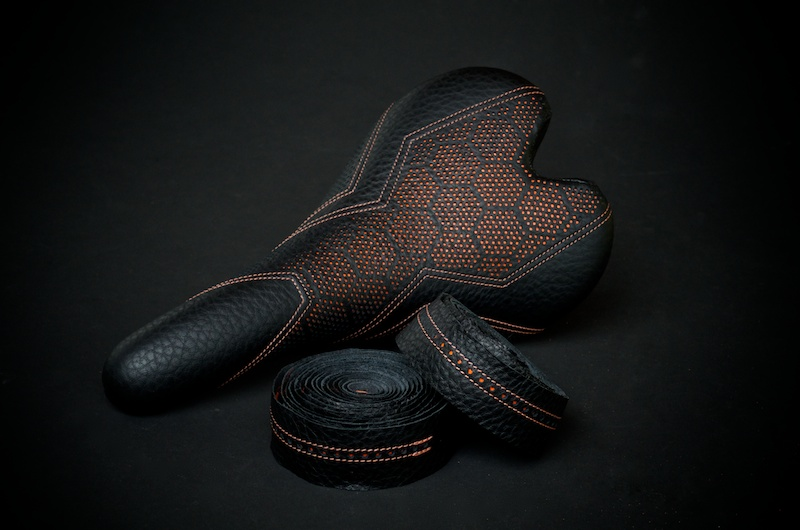 Fizik-Fi'Zi-K-Aliante-Carbon-recover-recovered-reupholstered-repaired-leather-black-orange-hexagon-honeycomb-Tron-stitching-handmade-pebbleleather-carbonfiber-lightweight-saddle-seat-bike-bicycle-leatherwork-made-in-Austin-Texas-Busyman-brook (6).jpg