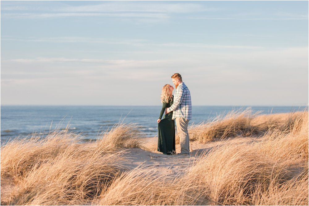 romantic-sunset-beach-engagement-photos-at-silver-beach-in-saint-joseph-mi-by-courtney-carolyn-photography_0001.jpg
