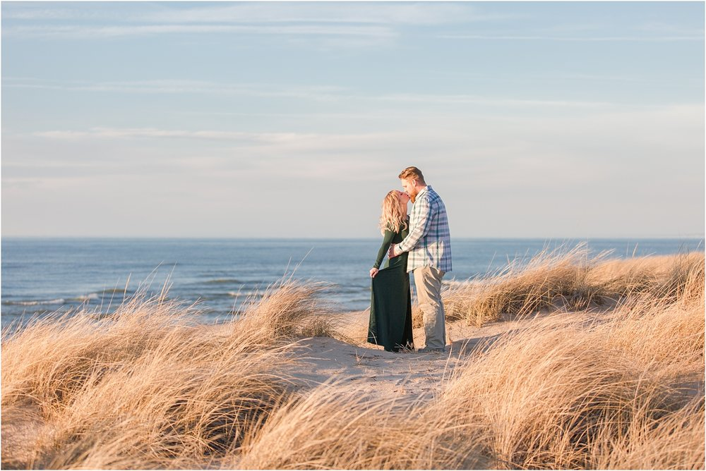 romantic-sunset-beach-engagement-photos-at-silver-beach-in-saint-joseph-mi-by-courtney-carolyn-photography_0010.jpg