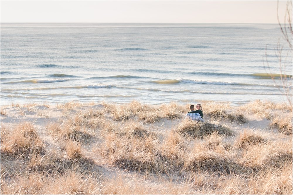 romantic-sunset-beach-engagement-photos-at-silver-beach-in-saint-joseph-mi-by-courtney-carolyn-photography_0014.jpg