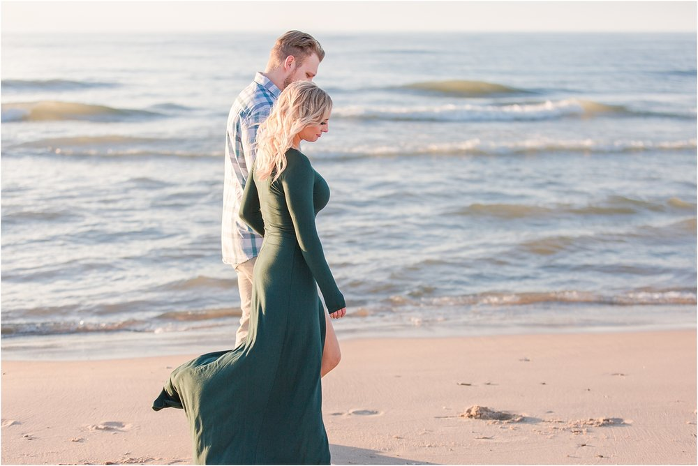 romantic-sunset-beach-engagement-photos-at-silver-beach-in-saint-joseph-mi-by-courtney-carolyn-photography_0022.jpg