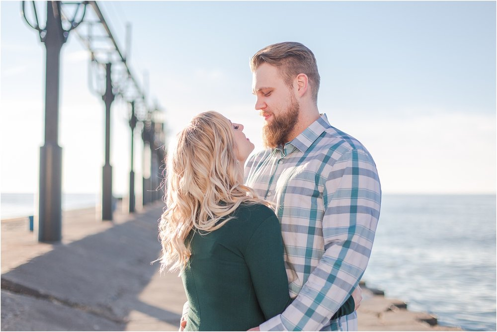 romantic-sunset-beach-engagement-photos-at-silver-beach-in-saint-joseph-mi-by-courtney-carolyn-photography_0024.jpg