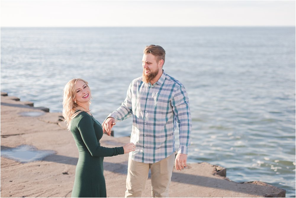 romantic-sunset-beach-engagement-photos-at-silver-beach-in-saint-joseph-mi-by-courtney-carolyn-photography_0028.jpg