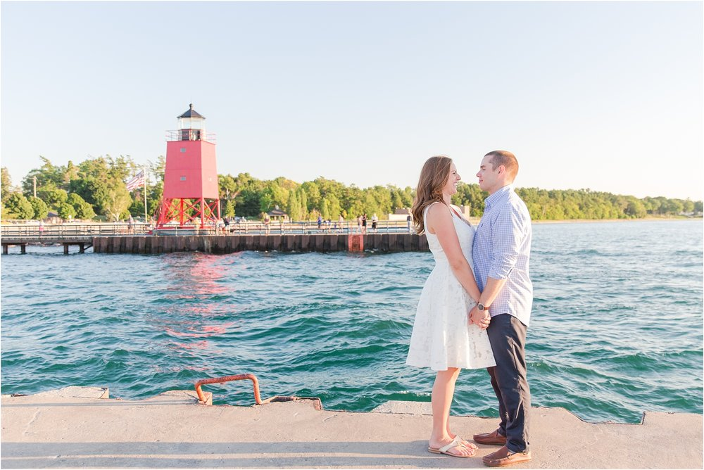 romantic-sunset-engagement-photos-in-downtown-charlevoix-mi-by-courtney-carolyn-photography_0001.jpg
