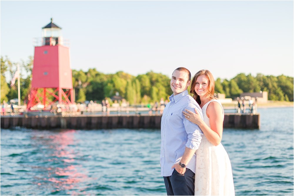 romantic-sunset-engagement-photos-at-the-lighthouse-in-charlevoix-mi-by-courtney-carolyn-photography_0007.jpg