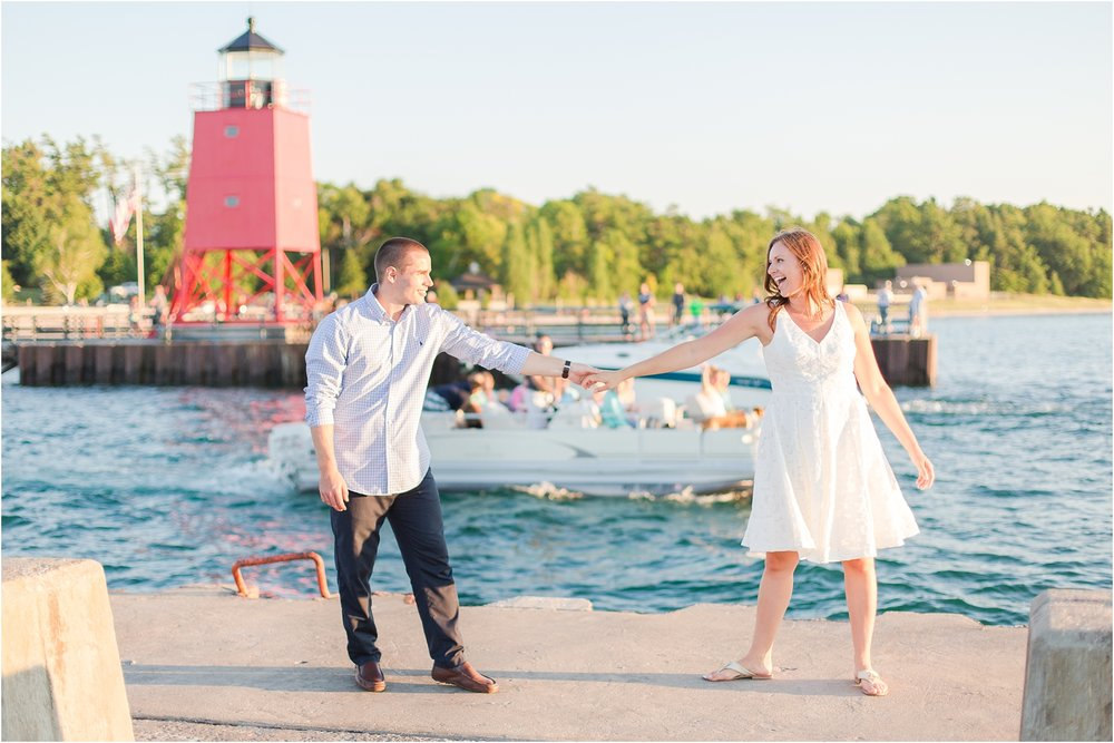 romantic-sunset-engagement-photos-at-the-lighthouse-in-charlevoix-mi-by-courtney-carolyn-photography_0013.jpg
