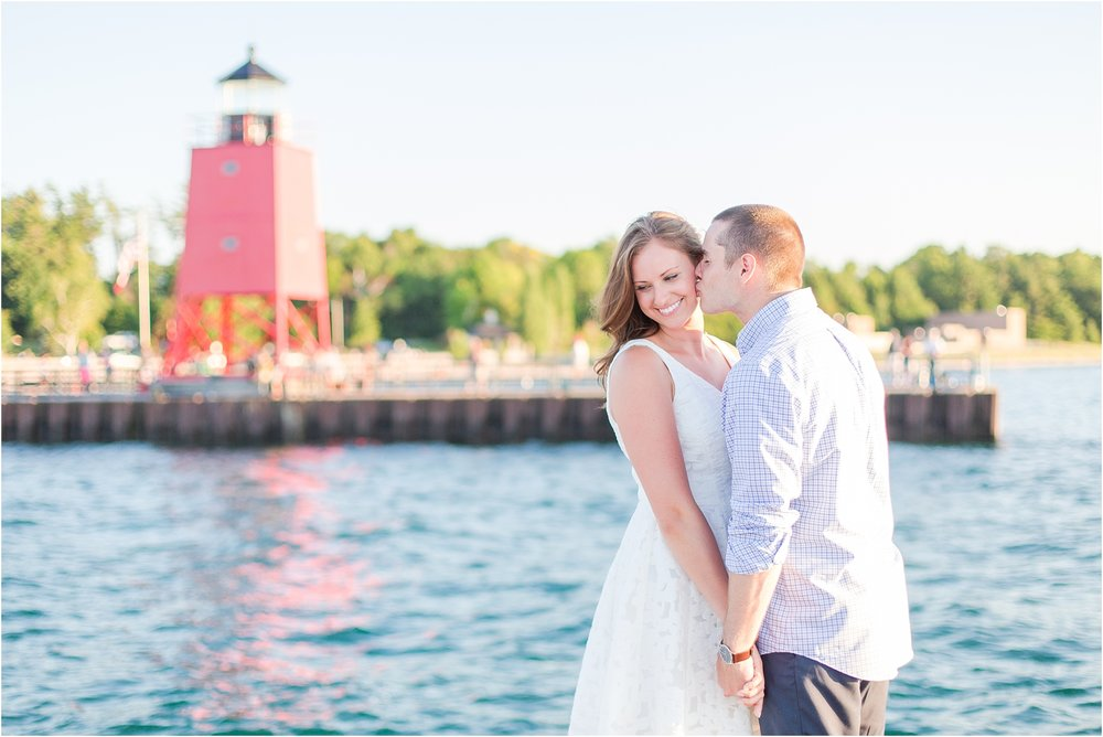 romantic-sunset-engagement-photos-at-the-lighthouse-in-charlevoix-mi-by-courtney-carolyn-photography_0016.jpg