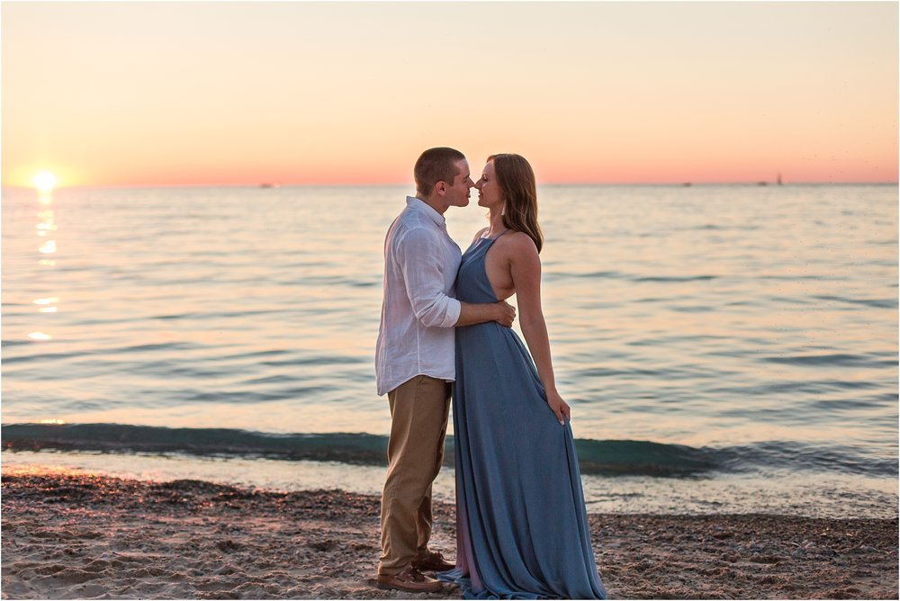 romantic-sunset-engagement-photos-at-michigan-beach-park-in-charlevoix-mi-by-courtney-carolyn-photography_0012.jpg
