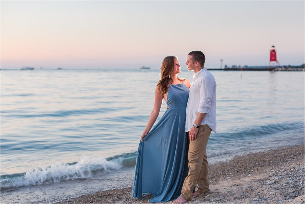 romantic-sunset-engagement-photos-at-michigan-beach-park-in-charlevoix-mi-by-courtney-carolyn-photography_0017.jpg