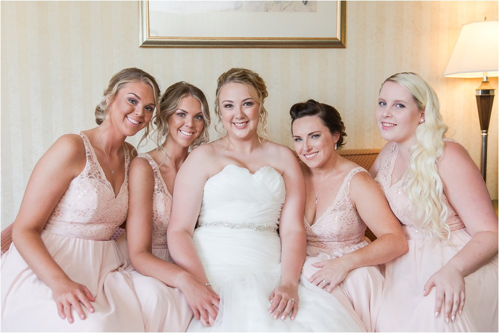 joyful-and-candid-navy-blush-wedding-photos-at-crystal-gardens-in-howell-mi-by-courtney-carolyn-photography_0023.jpg