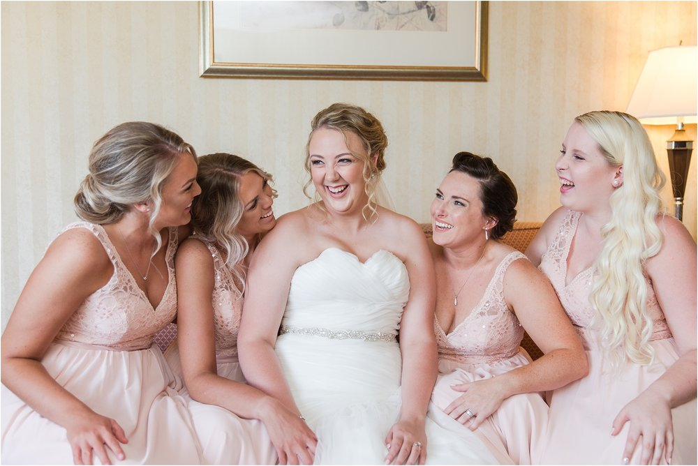 joyful-and-candid-navy-blush-wedding-photos-at-crystal-gardens-in-howell-mi-by-courtney-carolyn-photography_0026.jpg