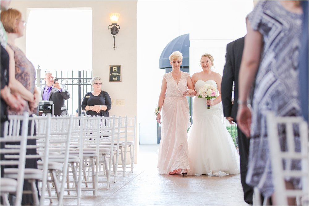 joyful-and-candid-navy-blush-wedding-photos-at-crystal-gardens-in-howell-mi-by-courtney-carolyn-photography_0030.jpg