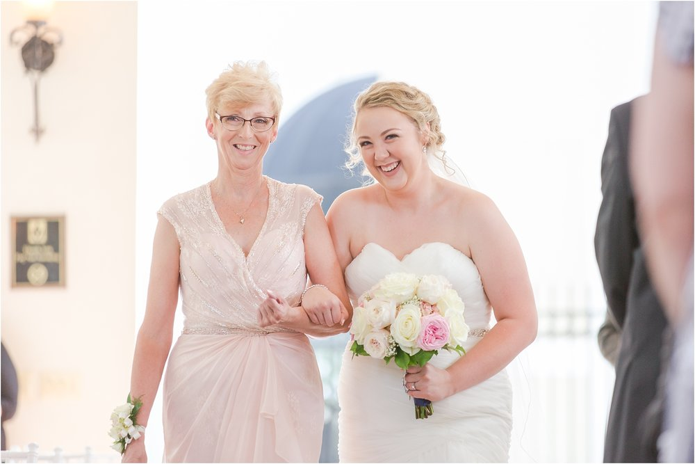 joyful-and-candid-navy-blush-wedding-photos-at-crystal-gardens-in-howell-mi-by-courtney-carolyn-photography_0031.jpg